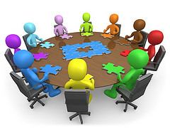 puzzle pieces meeting table